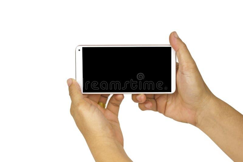 Nahaufnahmehand, die weißen Handy mit leerem schwarzem Schirm auf weißem Hintergrund mit cipping Weg hält stockfotos