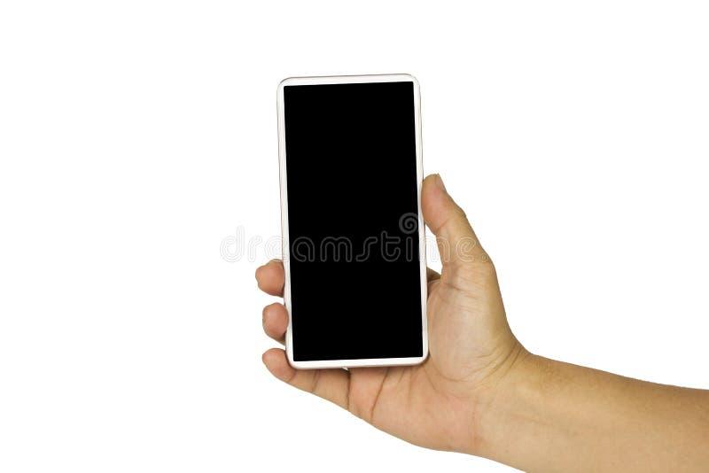Nahaufnahmehand, die wei?en Handy mit leerem schwarzem Schirm auf wei?em Hintergrund mit cipping Weg h?lt lizenzfreie stockbilder