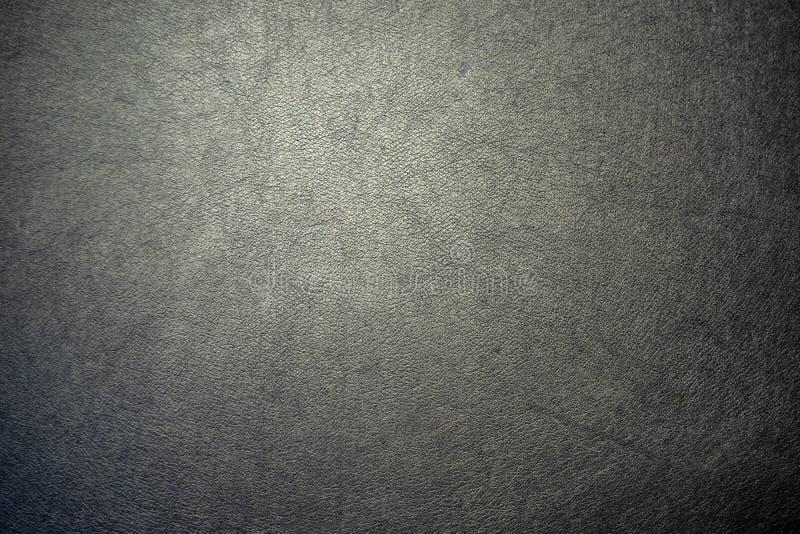 Nahaufnahmeoberfläche der schwarzen Farbe des Kunstleders für strukturierten Hintergrund stockfoto