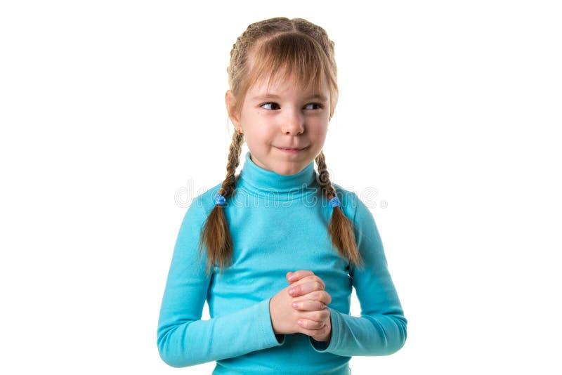 Nahaufnahmeporträt der hinterlistigen, schlauen, entwerfenden Mädchengrafischer darstellung etwas lokalisiert auf weißem Hintergr stockfoto