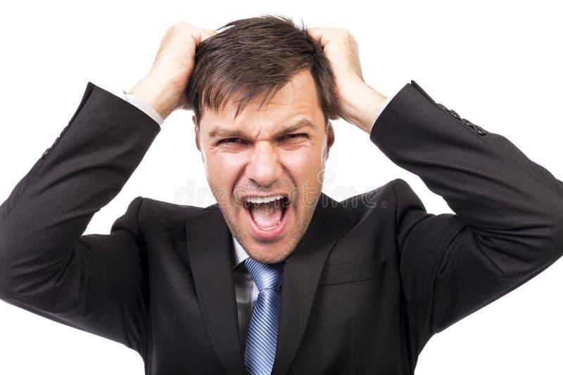 Nahaufnahmeporträt eines frustrierten Geschäftsmannes, der sein Haar zieht stockfotos
