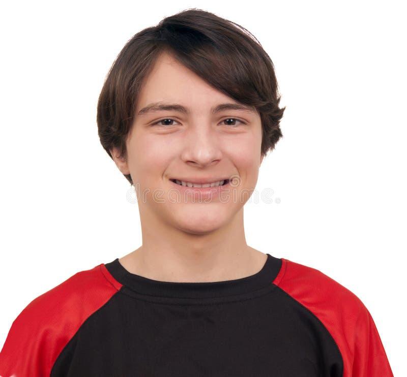 Nahaufnahmeporträt eines hübschen lächelnden Jugendlichen lizenzfreie stockfotografie