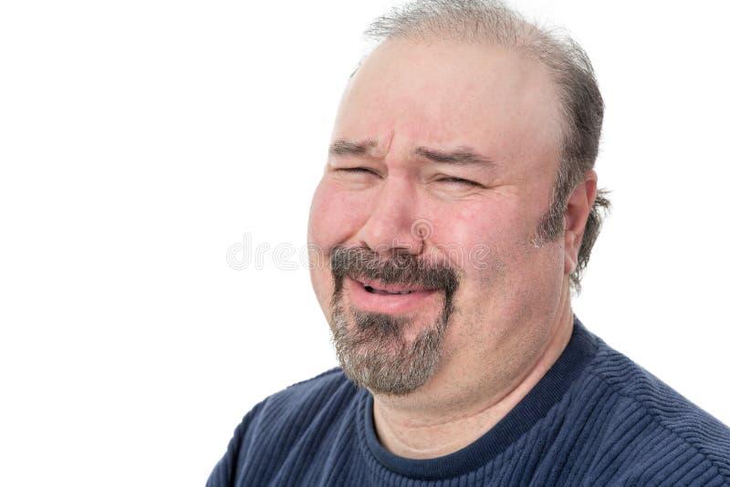 Nahaufnahmeporträt eines Mannes, der im Unglauben lacht lizenzfreie stockfotos
