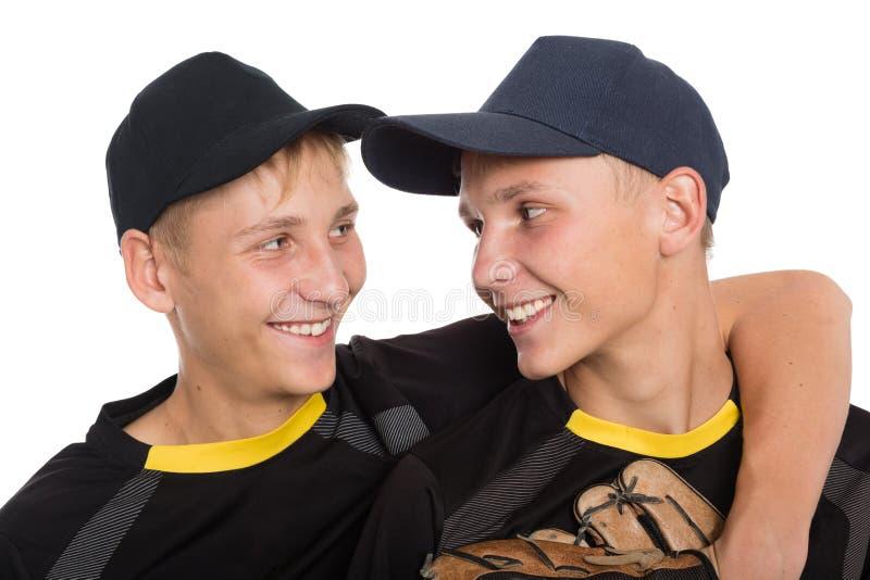 Nahaufnahmeporträt von Bruderbaseball-spielern stockfotografie