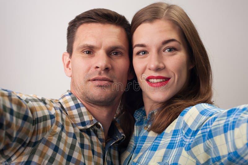 Nahaufnahmeporträt von Mitte gealterten Paaren stockbild