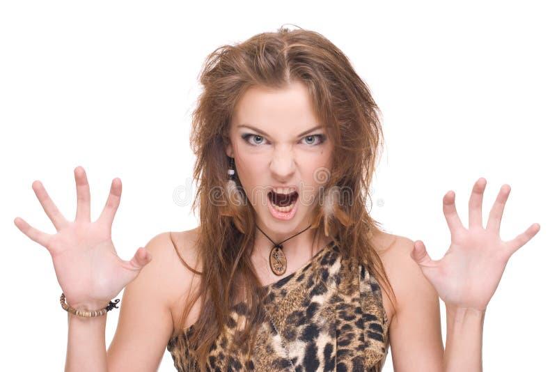 Nahaufnahmeportrait der jungen verärgerten wilden Frau stockfoto
