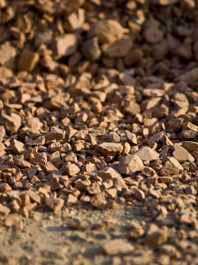Nahe Ansicht und Beschaffenheit des roten Lehms lizenzfreie stockfotografie