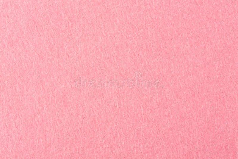 Nahe hohe Detailansicht eines rosa Stückes strukturierten geglaubten Gewebes mit rauer Note lizenzfreie stockbilder