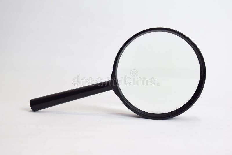 Nahe hohe Lupenlupe lokalisiert auf weißem Hintergrund stockbilder