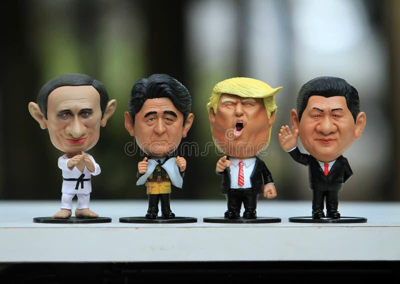 Naher hoher Schuss von vier Führern vorbildlich stockbilder