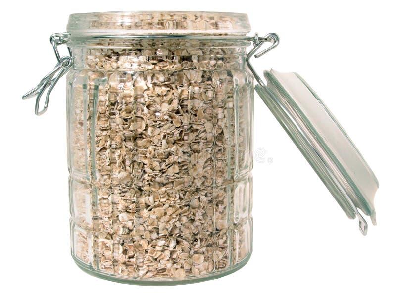 Nahrung: Rohe Hafer in einem Glasglas (getrennt) stockbild