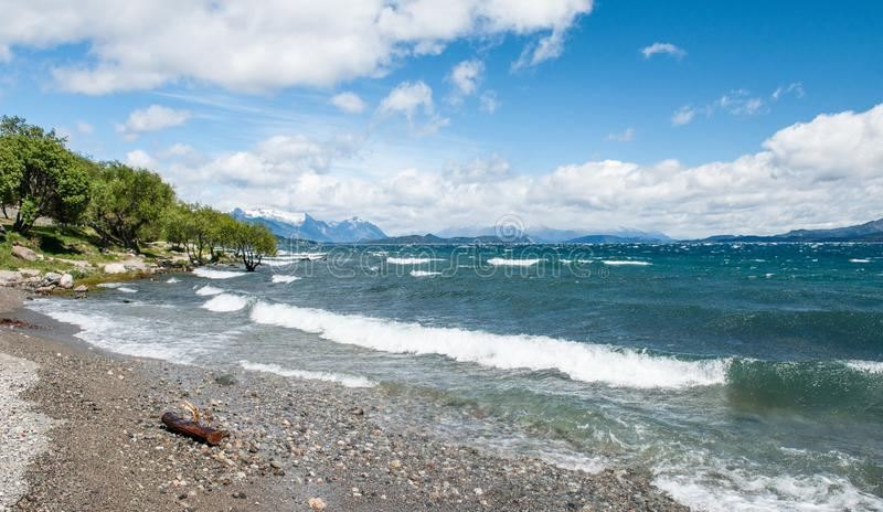 Nahuel Huapi lake, San Carlos de Bariloche Argentina. Waves on the lake. Mountains with fresh snow surrounding the lake.  stock photos