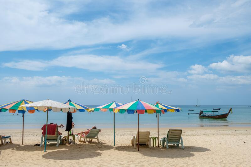 Nai Yang beach in Phuket. Unrecognizable tourist at Nai Yang Beach near Phuket International Airport. Phuket is large island and a major travel destination in stock photos
