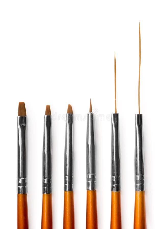 Nail art brushes royalty free stock photos