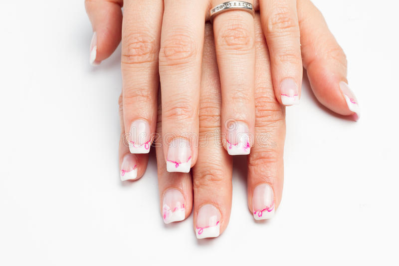 Nail art with colors pink white royalty free stock image