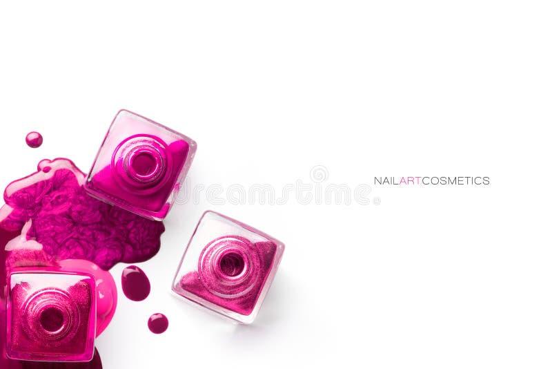 Nail art concept. Different shades of metallic pink nail polish stock image