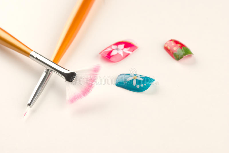 Nail art still life. Finished nails and several different nail art utensils stock photography