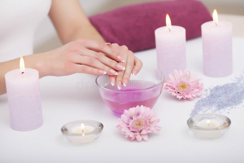 Nail Care. Closeup Of Beautiful Woman Hands With Natural Nails I royalty free stock images