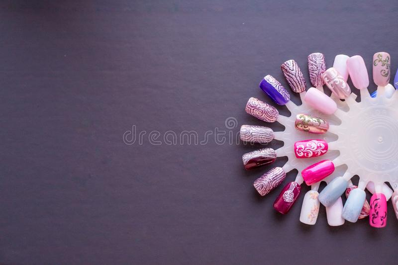 Nail color samples in different colors. Big collection of artificial finger nails painted in different coolors. Nail royalty free stock images