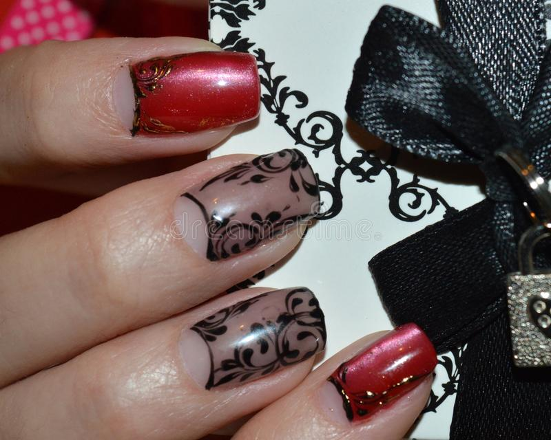 Nail Design: The Cat\'s Eye, Veil, Black And Golden Curls Stock Photo ...