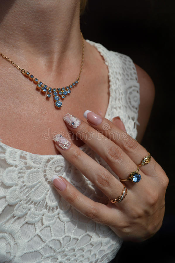Nail designs for bride: French manicure and velvet sand royalty free stock photos