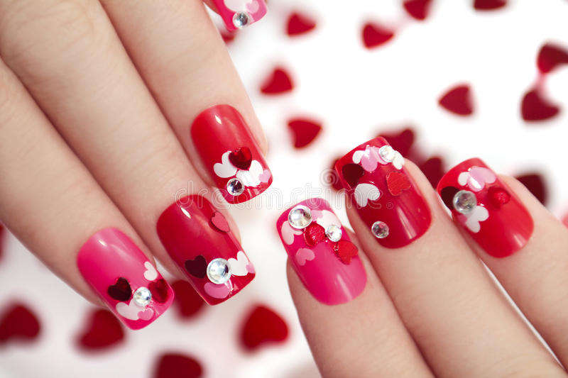 Nail designs with hearts. royalty free stock image