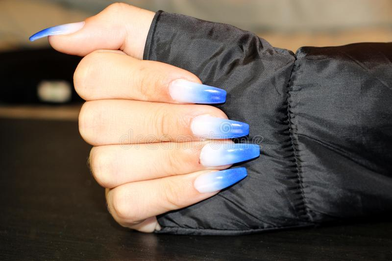 Nail Extensions of awesome colors stock photos