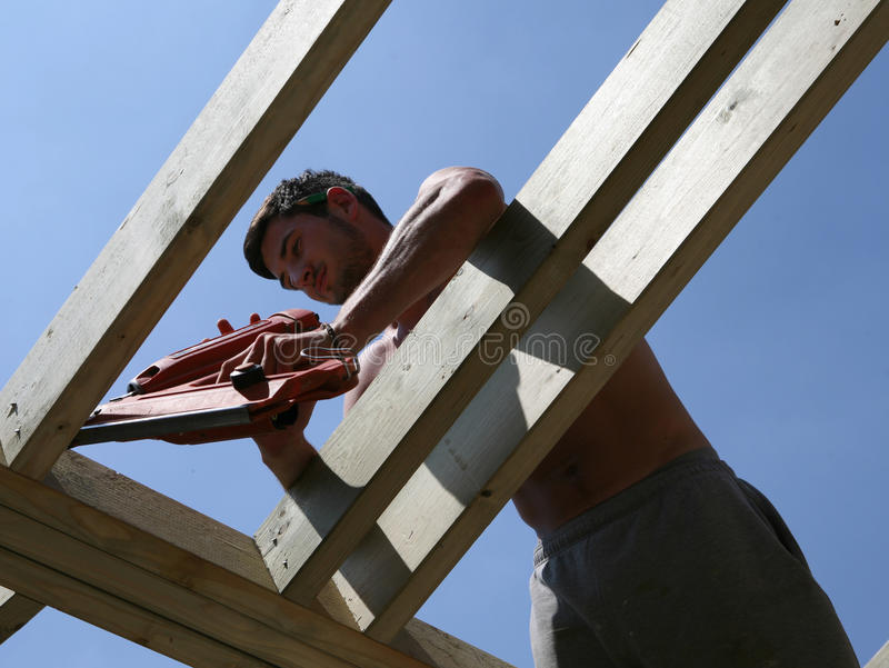 Download Nail Gun stock photo. Image of face, site, built, person - 14852620