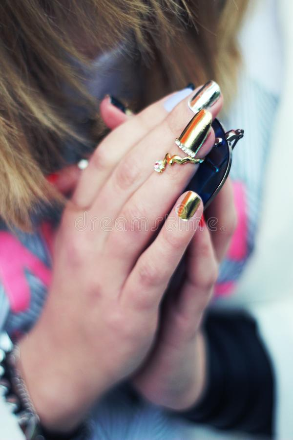 Nail jewelry royalty free stock photography
