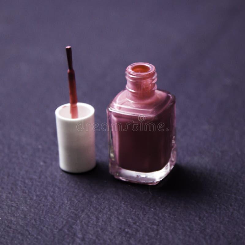 Nail Polish. On purple background stock photography