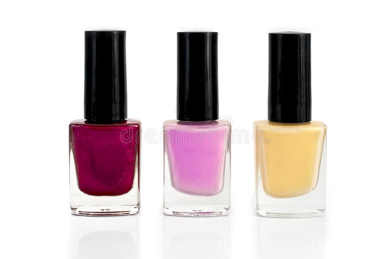 Nail polish bottles in three royalty free stock image