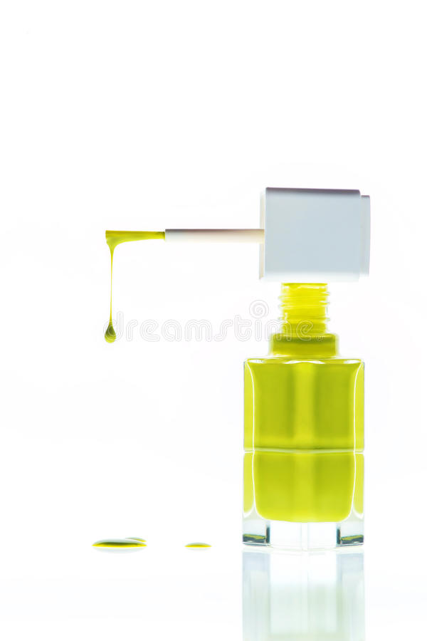 Nail polish. Close up of green nail polish flow on white background stock photo