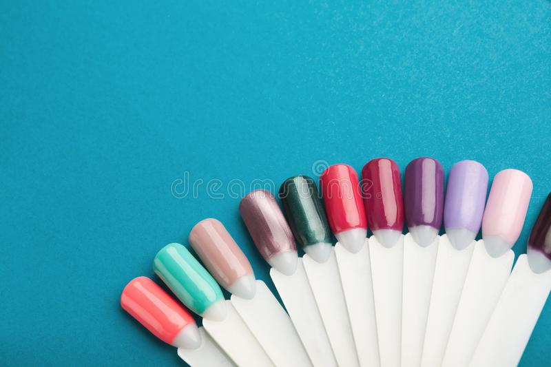 Nail polish color samples on blue background stock photo