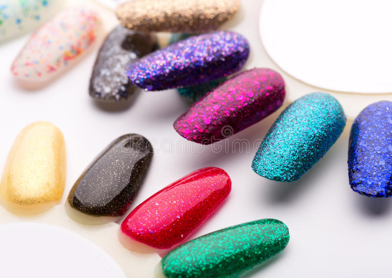 Nail polish in different fashion colors stock photography