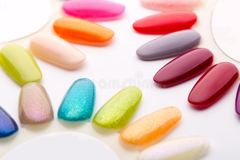 Nail polish in different fashion colors royalty free stock photo
