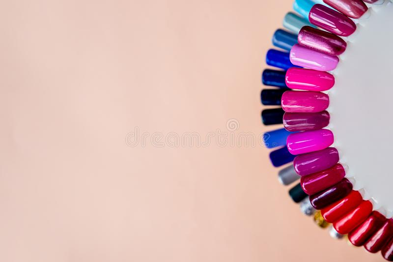 Nail polish samples in different bright colors. Colorful nail lacquer manicure swatches. Top view of nail art samples stock image