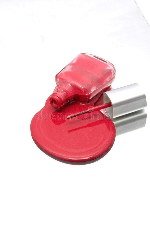 Nail Polish Spilling on a Mirror with the Brush royalty free stock photos
