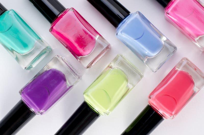 Nail polish tubes isolated on white background stock photos