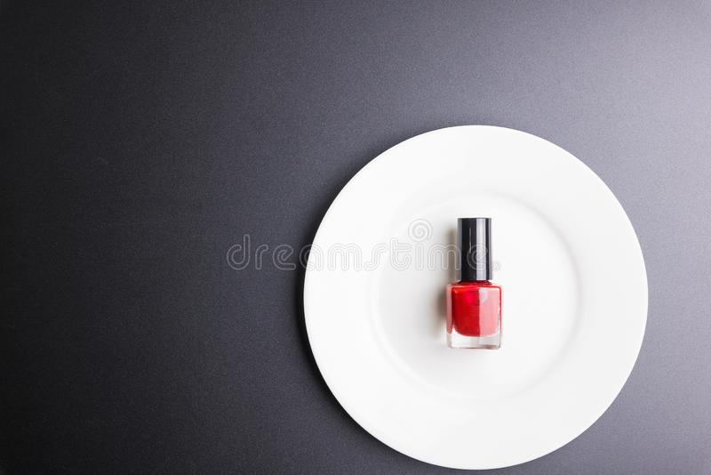 Nail polisher on white dish isolated on black background, Cosmetics concept, Makeup concept, Copy space image for your text, Flat. Lay stock images