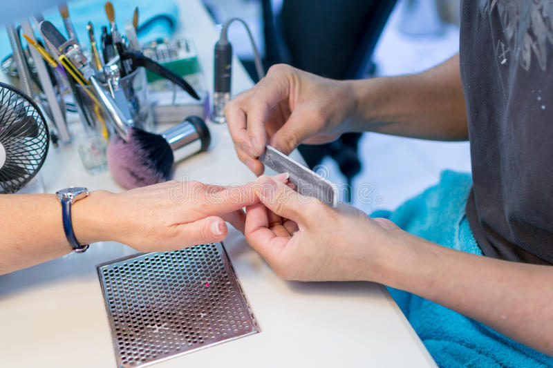 Nail Technician Working On A Elderly Woman\'s Nails Stock Image ...