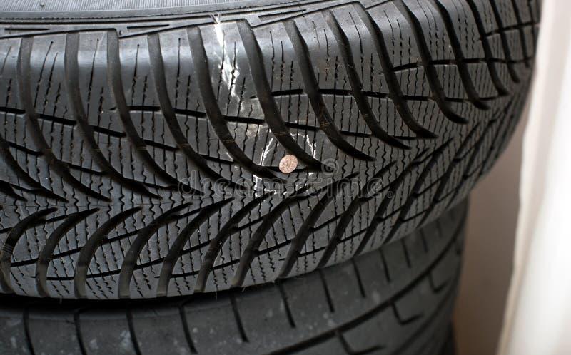 Nail in tyre stock image. Image of wheel, metallic, chalk - 65884233