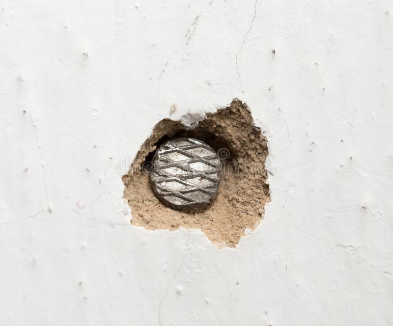 A nail in the wall. macro. Photos in the studio stock photo