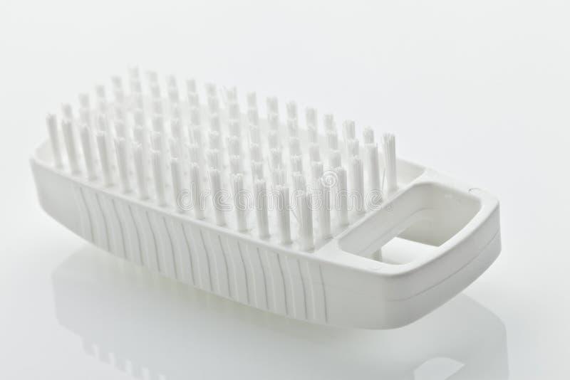 Nailbrush. A white nailbrush on white background stock photos