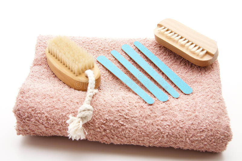 Nailbrush and nail file. On white background royalty free stock photography