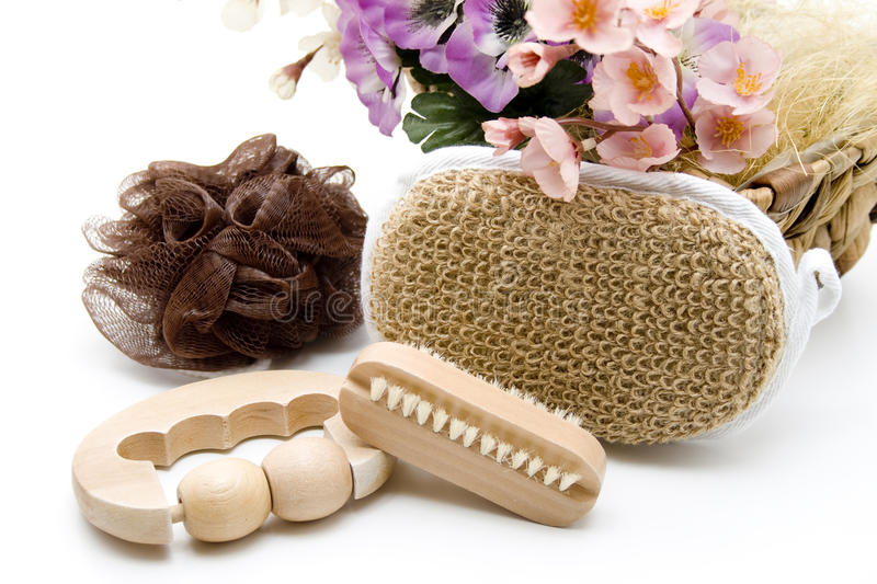 Nailbrush with sponge. And floral decoration stock photo