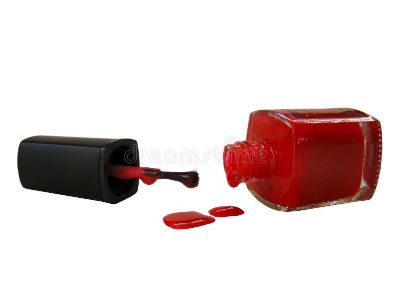Nailpolish rojo del goteo foto de archivo