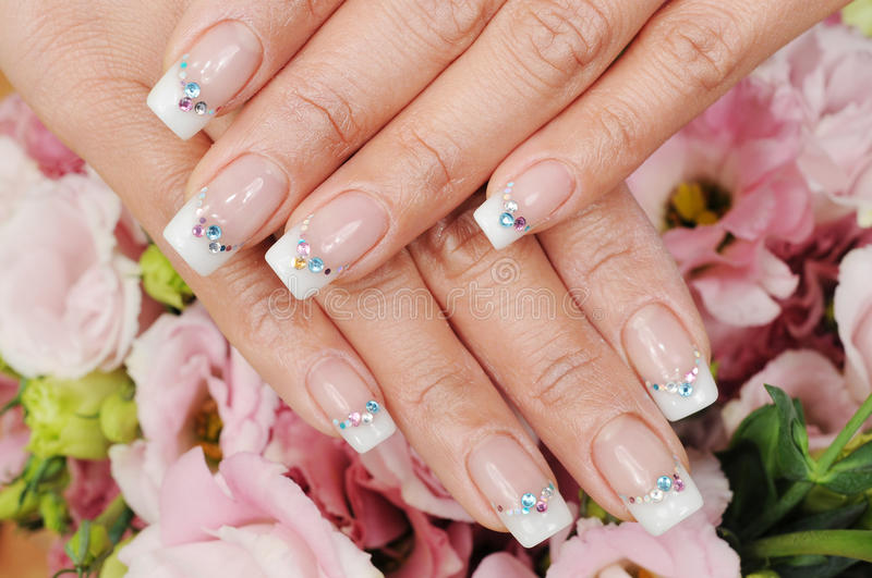 Nails. Woman hand with different nails royalty free stock images