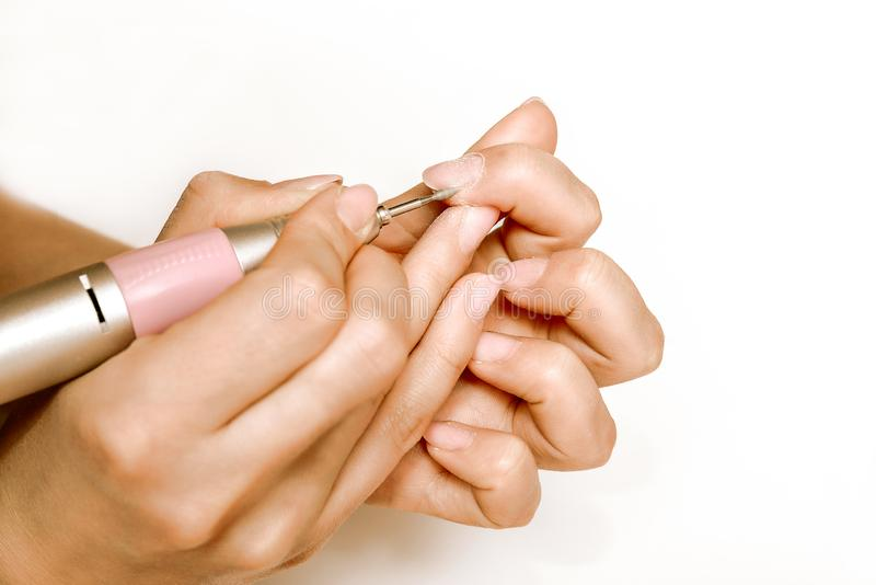 Nails Beauty. Closeup Of Woman Hands Receiving Nail Care Treatment.Manicurist Hands Cutting Cuticle On Nails With Nail Clippers royalty free stock photo