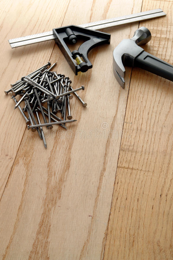 Nails And Carpentry Hammer On Wood Planks Stock Photo