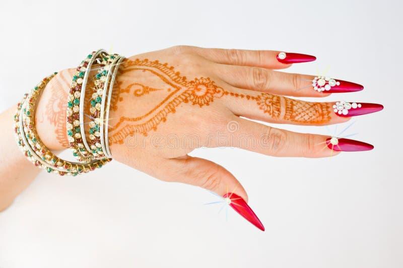 Download Nails Dekorerade Med Briljant Och Handen Med Hennatatueringar Arkivfoto - Bild av hand, dyrbart: 106829662